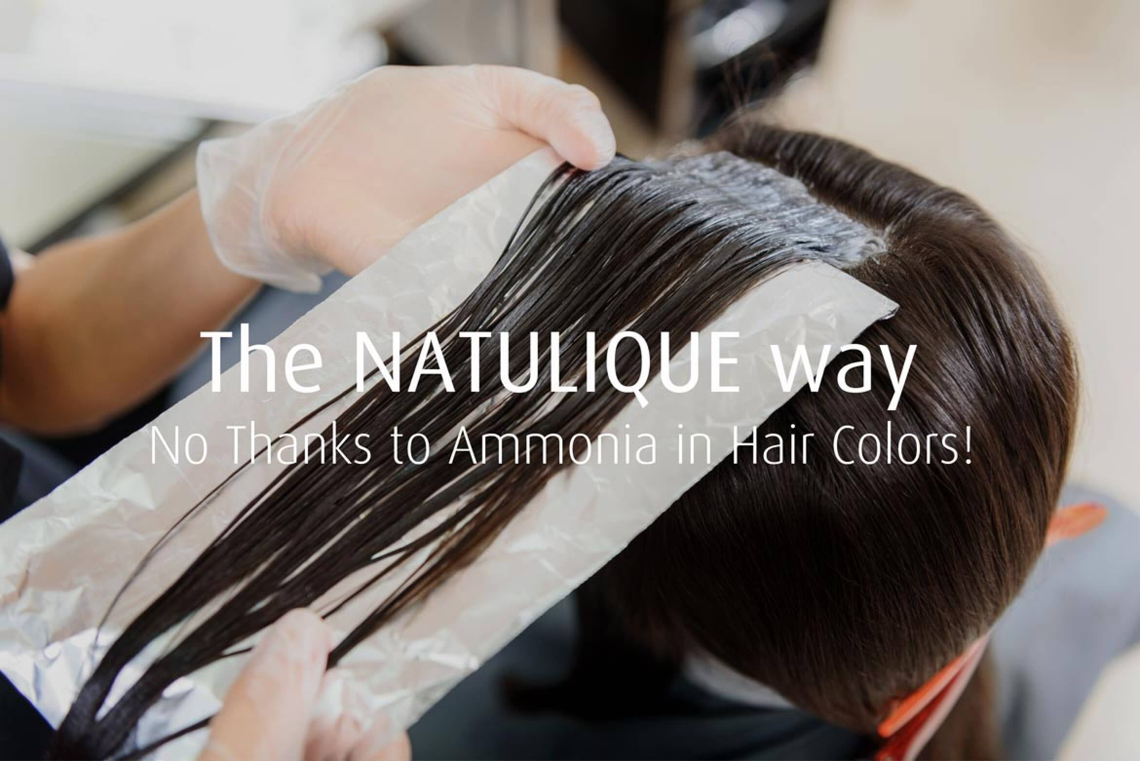 hairdresser coloring hair with ammonia free colours