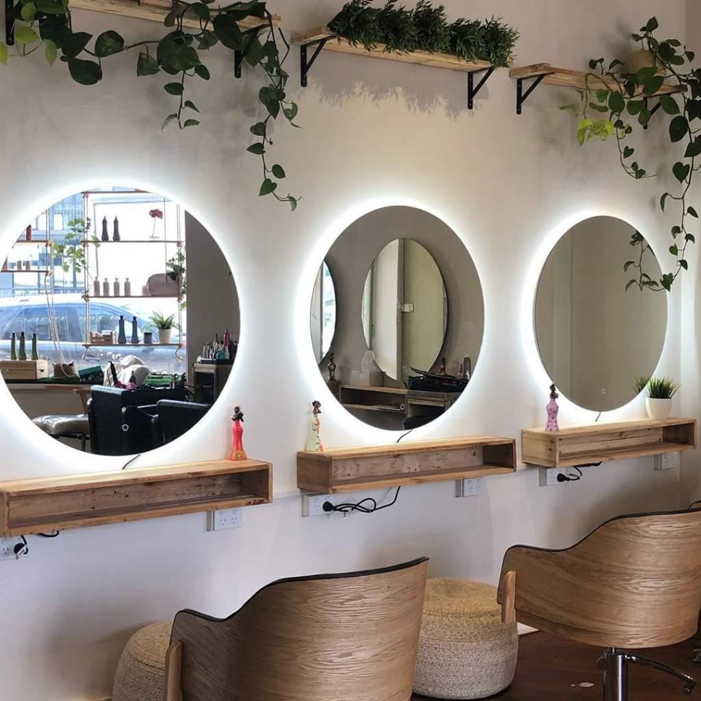large round mirrors in salon