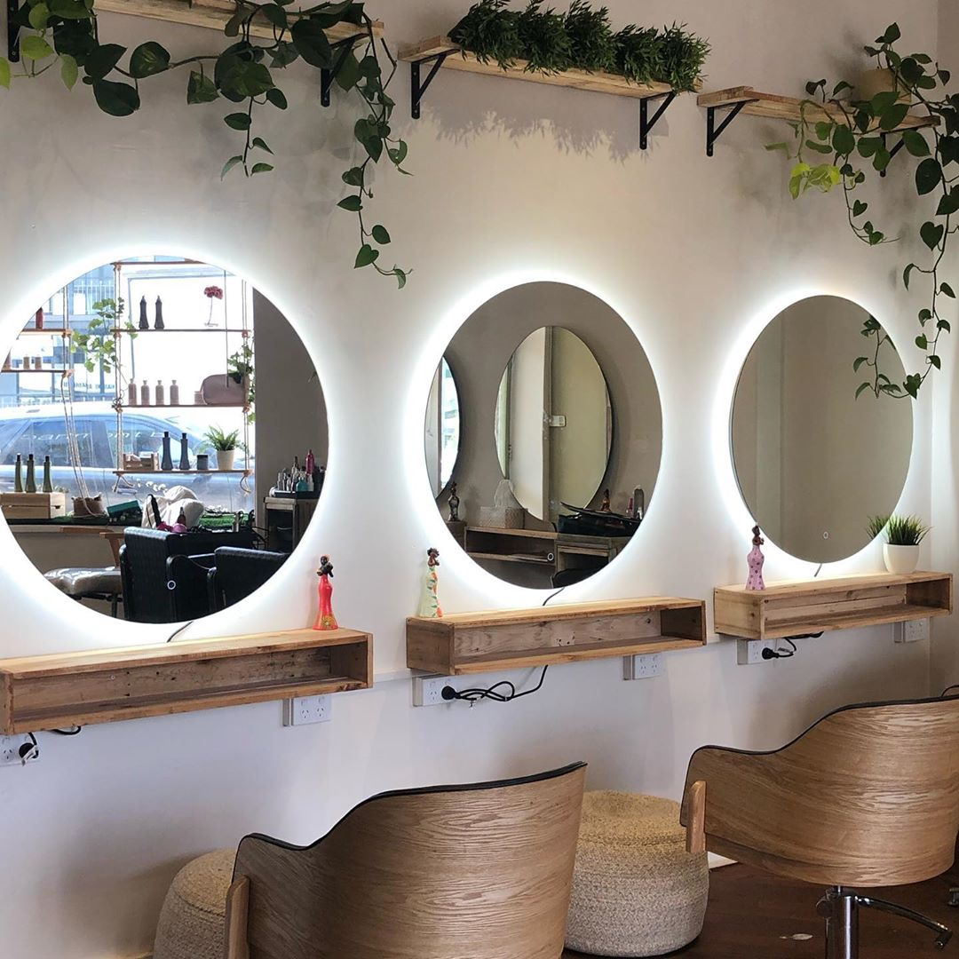 large round mirrors in salon